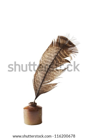 Quill feather pen stands in antique ceramic ink well. Brown glaze, striped feather in diagonal position. Vertical, isolated on white background.