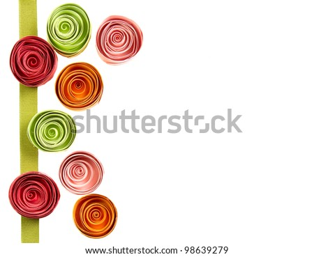 Quilled paper flowers for background, isolated on white