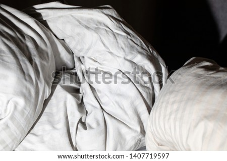 Quilt and bedclothes in a bedroom. #1407719597
