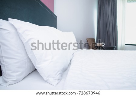 quilt bed  white pillows on white bed in bedroom #728670946