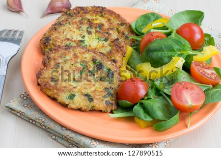 Quinoa pancakes and salad from fresh vegetables