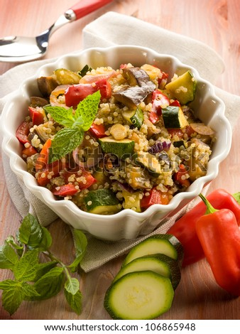 quinoa salad with vegetables, vegetarian food - stock photo