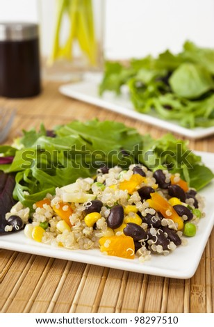 Quinoa vegetable salad with mixed greens