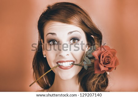 Quirky Face Portrait Of A Shocked Pinup Girl Wearing Vintage Makeup Holding A Red Rose In Mouth In A Valentines Day Gift Conceptual