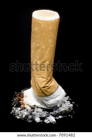 Quit smoking - cigarette butt isolated over black