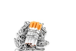 Quit smoking. Cigarettes in chains on white background copy space