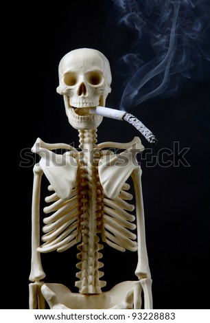 Quit smoking concept a human skeleton with cigarette on black background