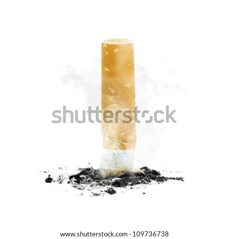Quit smoking concept with a cigarette butt stubbed out amidst ash and smoke on white background