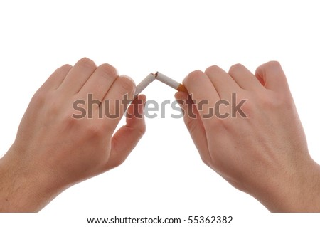 Quit smoking, hands are breaking a cigarette.