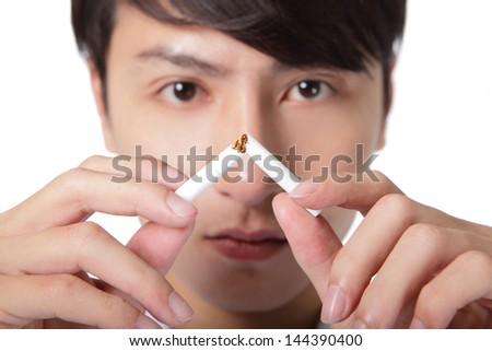 Quit smoking, man hands breaking the cigarette, close up, asian model