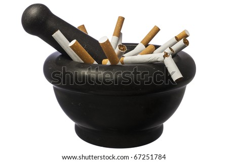 Quit smoking - Pestle and mortar with crushed cigarettes isolated over white