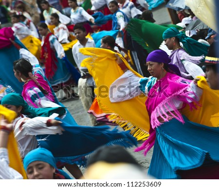 QUITO, DECEMBER 5: People in traditional Ecuadorean dresses dance as part of a parade through the streets celebrates its Spanish Foundation on  December 5, 2010 in Quito, Ecuador - stock photo