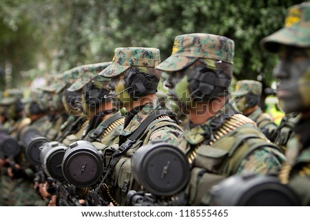 QUITO, ECUADOR- MAY 24:  National  military parade, unidentified camouflage row of soldiers with army and military gear. May 24, 2012, Quito, Ecuador