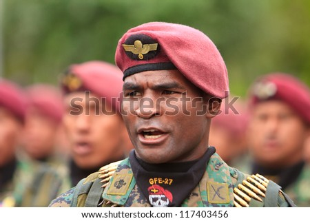 QUITO, ECUADOR- MAY 24 2012 National  military parade, unidentified camouflage troop leader in formation. May 24, 2012, Quito, Ecuador