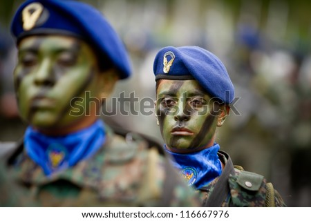 QUITO, ECUADOR- MAY 24 2012 National  military parade, unidentified camouflage  woman soldier with facepaint and military gear. May 24, 2012, Quito, Ecuador