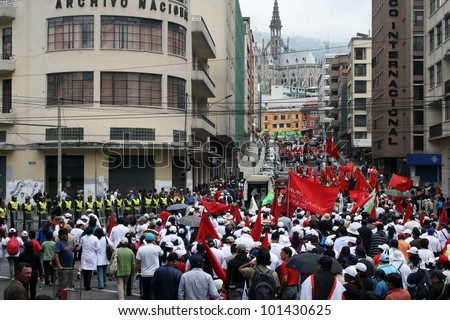 QUITO, ECUADOR - MAY 01: People marching in the parade on International Workers Day, also known as Labour Day, on may 01, 2012 in Quito, Ecuador