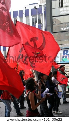 QUITO, ECUADOR - MAY 01: Supporters of the Ecuadorian communist party in the parade on International Workers Day, also known as Labour Day, on may 01, 2012 in Quito, Ecuador