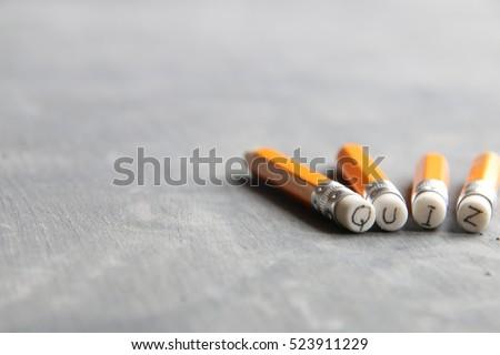 Quiz concept, inscription on pencil