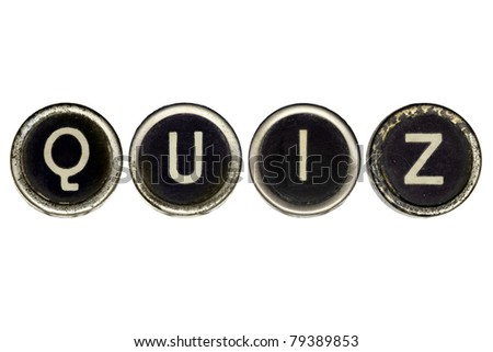 Quiz spelled in vintage typewriter keys.  Isolated on white.  Lots of dust and scratches on the keys.
