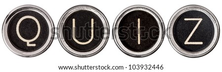 QUIZ spelled out in old, scratched chrome typewriter keys with black centers and white letters.  Isolated on white with clipping path.