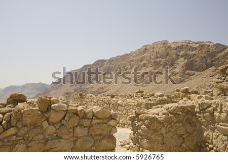 Qumran ruins with mountains in background
