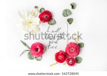 "Quote ""Do small things with great love"" written in calligraphic style on paper with pink, red roses, ranunculus, white tulips and green leaves on white background. Flat lay, top view #563728045"