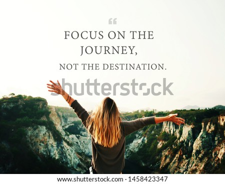 Quote - focus on the journey not the destination written on women feeling happiness on mountains background. Retro style. #1458423347