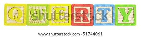 qwerty written with wooden alphabet blocks isolated against white background