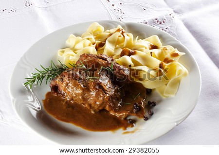 Rabbit Steak With Pasta Noodles , Rosemary And Spicy Sauce Stock Photo ...