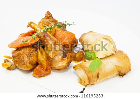 rabbit stew with mushroom sauce and cheese rolls