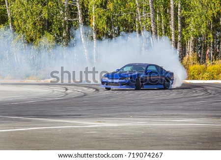 Race car drifting on speed track