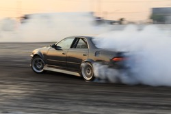 Race car drifting on speed track, Professional driver drifting car on race track with smoke, Abstract texture and background black tire tracks skid on asphalt road, Wheel tire tracks background.