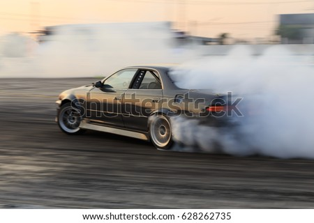 Race car drifting on speed track, Professional driver drifting car on race track with smoke.