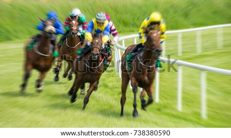 Race horses and jockeys motion blur zoom effect #738380590
