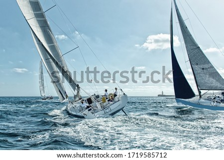 Race of sailing yachts. Sails in the sea. Yachting