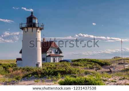 Race Point Light Lighthouse in sand dunes on the beach at Cape Cod, New England, Massachusetts, USA.