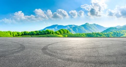 Race track road and green tea mountain on a sunny day,panoramic view.
