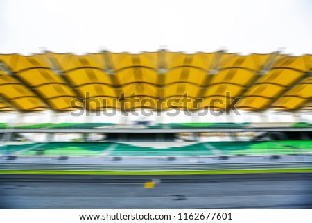 Race track with motion blur effect. Motorsports racing circuit background. #1162677601