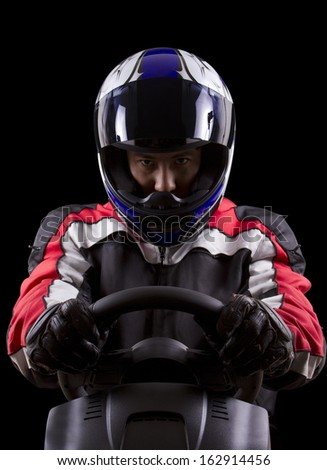 racerwearing red racing suit and blue helmet on a steering wheel #162914456