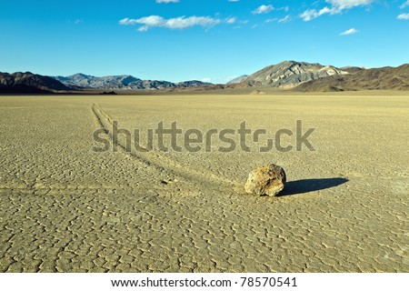"Racetrack Playa, Death Valley National Park, California. The Racetrack Playa, or The Racetrack, is a scenic dry lake feature with ""sailing stones"" that leave linear ""racetrack"" imprints."