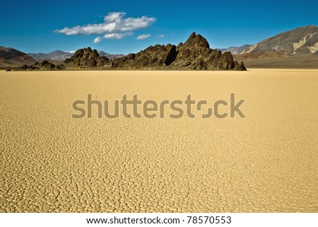"""Racetrack Playa, Death Valley National Park, California. The Racetrack Playa, or The Racetrack, is a scenic dry lake feature with """"sailing stones"""" that leave linear """"racetrack"""" imprints."""