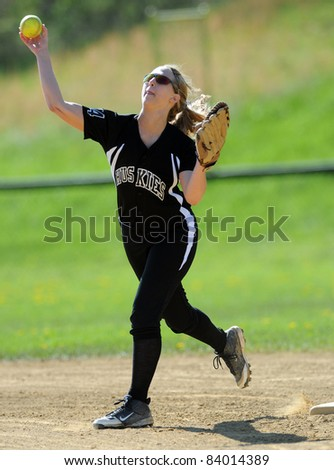RACHEL, WV - APRIL 21: A North Marion HS (WV) softball player throws the ball in the infield during pregame drills prior to a game April 21, 2011 in Rachel, WV.
