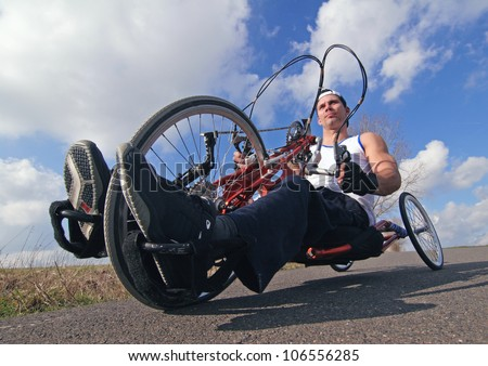 racing bike for a wheelchair user, wheelchair user on his racing bike on a summer day