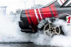 racing car drift in smoke of rubber