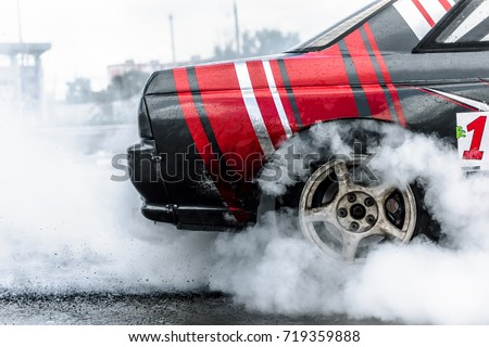 racing car drift in smoke of rubber #719359888
