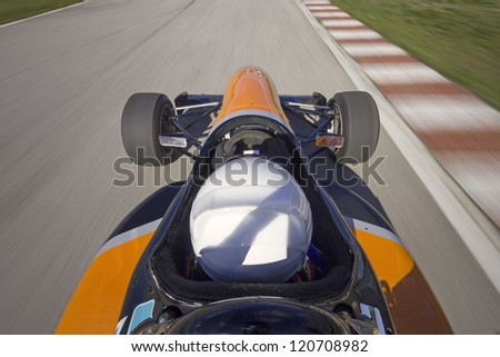 racing car driving at high speed in circuit.Camera on board