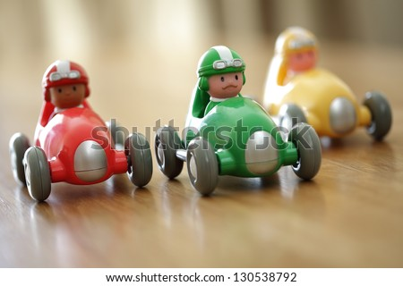 Racing cars on a table top racetrack concept for competition or childhood