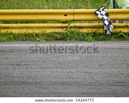 Racing checkered flag near a race track