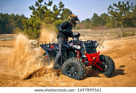 Racing powerful quad bike on the difficult sand in the summer. Stock photo ©