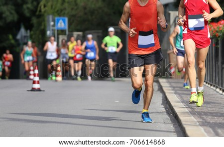 Racing race with athletes running fast on the streets of the city #706614868